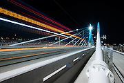 Portland's 17 Max Train goes by during a long exposure on Tilikum Crossing.