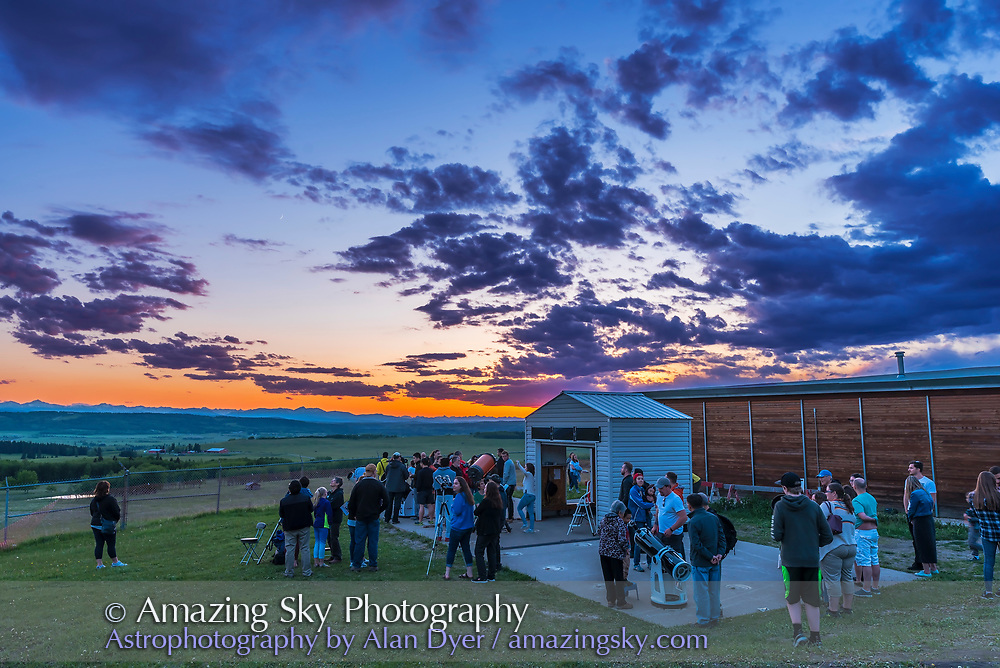 Public stargazing at the May 27, 2017 Open House at the Rothney Astrophysical Observatory, near Calgary, Alberta, on a fine spring evening with a beautiful sunset. The waxing crescent Moon is to the left in the west over the Rockies. A great aurora display followed after nightfall.
