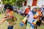 28 JUNE 2014 - DAN SAI, LOEI, THAILAND: People dance during the Ghost Festival on the grounds of Wat Ponchai in Dan Sai during the Ghost Festival. Phi Ta Khon (also spelled Pee Ta Khon) is the Ghost Festival. Over three days, the town's residents invite protection from Phra U-pakut, the spirit that lives in the Mun River, which runs through Dan Sai. People in the town and surrounding villages wear costumes made of patchwork and ornate masks and are thought be ghosts who were awoken from the dead when Vessantra Jataka (one of the Buddhas) came out of the forest.   PHOTO BY JACK KURTZ