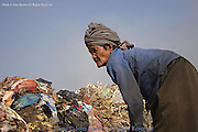 An elderly woman searches for recyclable material at the Stung Meanchey Landfill in Phnom Penh, Cambodia. Over 700 tons of garbage is dumped there daily. Among the 2000 workers are several senior citizens.