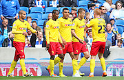 Watford Troy Deeney is congratulated after his opening goal during the Sky Bet Championship match between Brighton and Hove Albion and Watford at the American Express Community Stadium, Brighton and Hove, England on 25 April 2015. Photo by Phil Duncan.