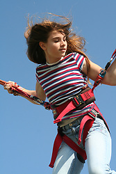 Pretty teenager jumping on a bungee jump ride