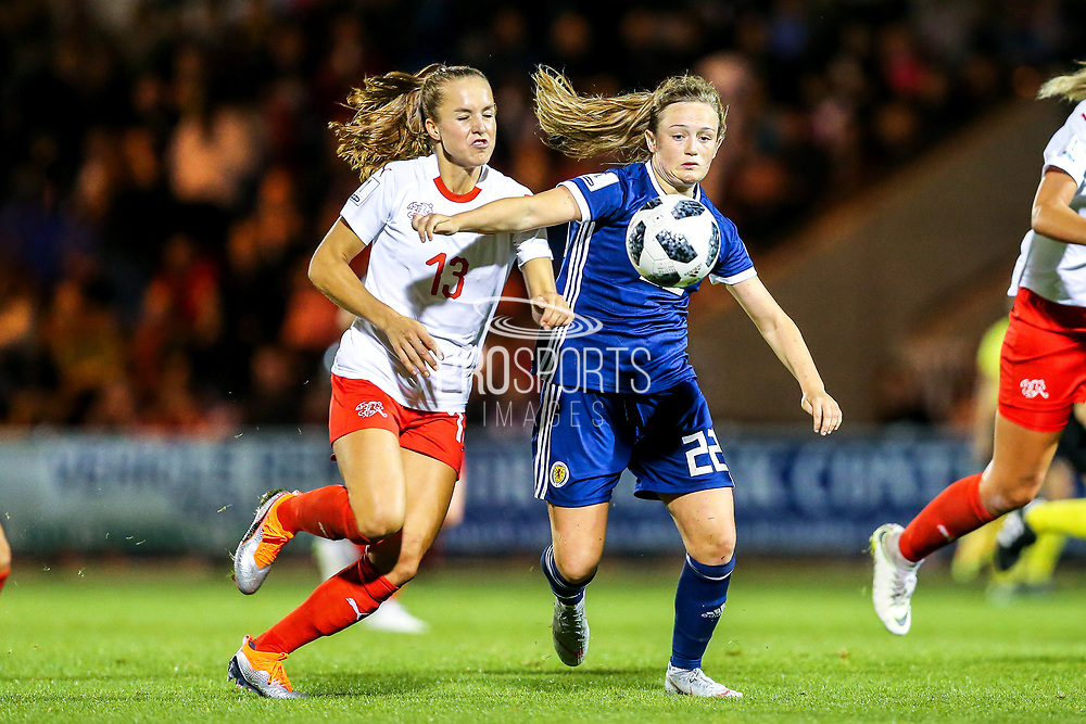 Erin Cuthbert (#22) of Scotland steps in to win the ball from Lia Walti (#13) of Switzerland during the 2019 FIFA Women's World Cup UEFA Qualifier match between Scotland Women and Switzerland at the Simple Digital Arena, St Mirren, Scotland on 30 August 2018.