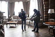 A group of Maidan activists led by journalist Tetyana Chornovol raid a lavish log house belonging to multimillionaire Sergey Kurchenko, a young businessman accused of being a frontman for former Ukrainian president Viktor Yanukovich, in search for documents connecting his business to former President's family. The guarded estate is located by the Dniepr bank in Pereyaslav, 100 kms south of Kiev. Kurchenko has fled the country when Yanukovych's regime collapsed on February 21. 25 February 2014.