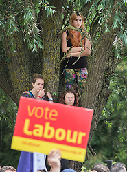 © Licensed to London News Pictures. 31/05/2017. Reading, UK. Supporters watch from a tree as Leader of the Labour Party JEREMY CORBYN speaks during a rally at Rivermead Leisure Centre in Reading, Berkshire, ahead of a general election on June 8. Mr Corbyn has announced that he will join an seven way election debate tonight in Cambridge. Prime Minister Theresa May has said she will not attend. Photo credit: Peter Macdiarmid/LNP