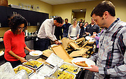 eVestment employees crowd into a popular and casual weekly lunch when word gets out via office email Wednesday, March 4, 2015, in Marietta, Ga. David Tulis / AJC Special