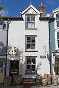 The location of Laura Ashley's first shop in Machynlleth, on 12th September 2018, in Machynlleth, Wales. Laura Ashley (1925-1985) was a Welsh fashion designer and businesswoman. She originally made furnishing materials in the 1950s, expanding the business into clothing design and manufacture in the 1960s. Ashley's first shop was opened at 35 Maengwyn Street, Machynlleth, Montgomeryshire, in 1961 - eventually becoming a global brand. The Laura Ashley style is characterised by Romantic English designs — often with a 19th-century rural feel — and the use of natural fabrics.
