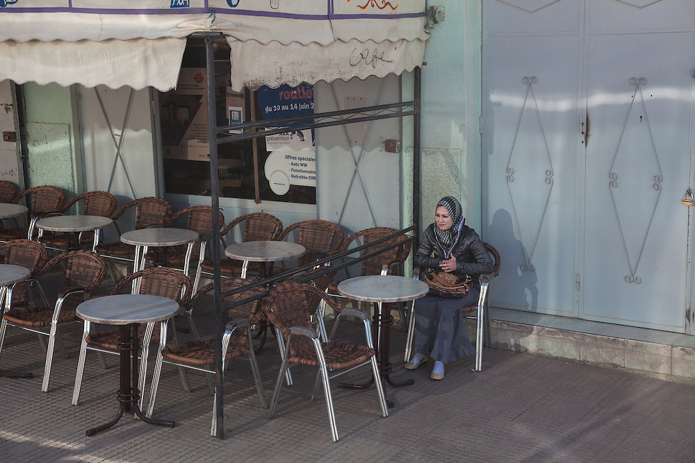 on the way to Midelt, March 2015. A girl alone sitting outside a cafè.