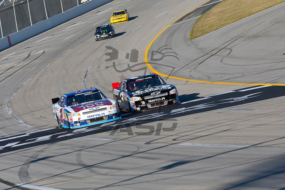 SPARTA, KY - SEP 22, 2012:  Elliot Sadler (2) and Austin Dillon (3) race during the Kentucky 300 at the Kentucky Speedway in Sparta, KY.