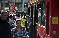 © Licensed to London News Pictures. 09/07/2015. London, UK. A man getting off a bus at Victoria Station. Commuters stranded at Victoria Station in London on the day of a network wide tube strike which finishes at 9.30 this evening. Photo credit: Ben Cawthra/LNP