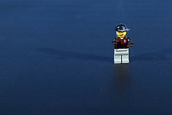 26 August 2015:   Studio - Lego man in soccer outfit on black background.