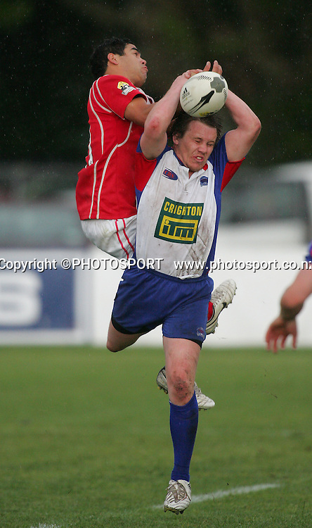 Poverty Bay's Shane Leach jumps over Michael Papps for a high ball. Poverty Bay won 26-5. Lochore Cup Final, Poverty Bay v Horowhenua Kapiti, Gisborne, 25 October 2008,  Photo: John Cowpland/PHOTOSPORT
