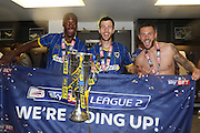 Tom Elliott forward for AFC Wimbledon (9),Paul Robinson defender for AFC Wimbledon (6),Callum Kennedy defender for AFC Wimbledon (3) celebrate AFC Wimbledon winning promotion to league 1after the Sky Bet League 2 play off final match between AFC Wimbledon and Plymouth Argyle at Wembley Stadium, London, England on 30 May 2016. Photo by Stuart Butcher.