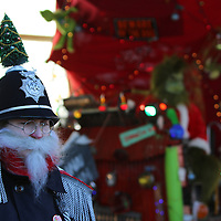 Libby Ezell | BUY AT PHOTOS.DJOURNAL.COM<br /> The Grinch was being monitored by Constable Who-Dunnit to make sure he didn't try and steal anymore presents Saturday at the Oren Dunn City Museum