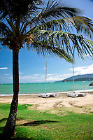 A couple of catarmans sit on  the shore in Airlie Beach, Queensland.