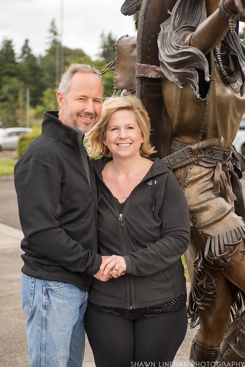 Heather Soderberg and her husband Rich Greene poses with her sculpture of Sacagawea in Cascade Locks, Oregon.