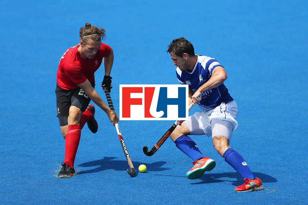 LONDON, ENGLAND - JUNE 20:  Taylor Curran of Canada and Timothy Atkins of Scotland battle for the ball during the Pool B match between Scotland and Canada on day six of the Hero Hockey World League Semi-Final at Lee Valley Hockey and Tennis Centre on June 20, 2017 in London, England.  (Photo by Alex Morton/Getty Images)