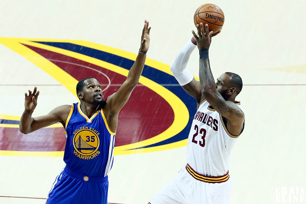 09 June 2017: Cleveland Cavaliers forward LeBron James (23) takes a jump shot over Golden State Warriors forward Kevin Durant (35) during the Cleveland Cavaliers 137-11 victory over the Golden State Warriors, in game 4 of the 2017 NBA Finals, at  the Quicken Loans Arena, Cleveland, Ohio, USA.