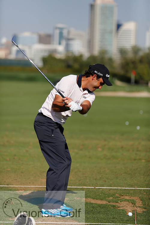 Edoardo MOLINARI<br /> Omega Dubai Desert Classic, Emirates GC, UAE, January 2014<br /> Picture Credit:  Mark Newcombe / www.visionsingolf.com