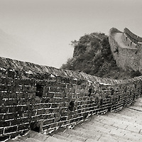 Chinese man walking on the Great Wall of China in the Jinshanling section of the wall