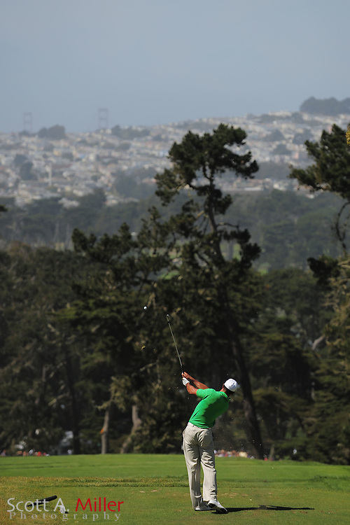 With the Golden Gate Bridge in the distance, Tiger Woods tees off on the third hole during the third round of the 112th U.S. Open at The Olympic Club on June 16, 2012 in San Fransisco. ..©2012 Scott A. Miller