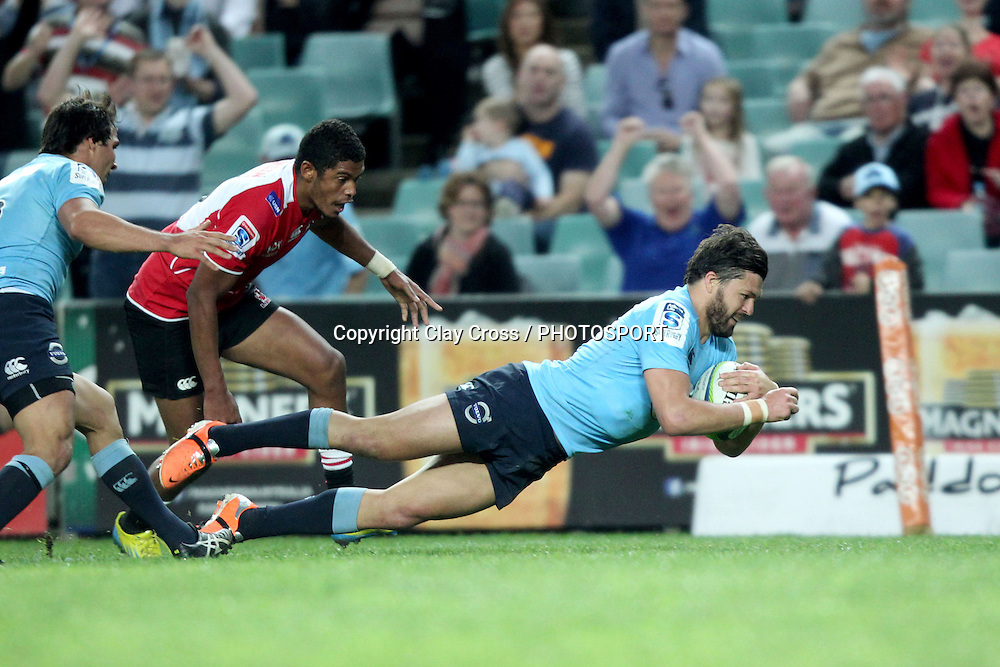 Adam Ashley-Cooper dives over to score a try during the NSW Waratahs v Lions 2014 Super Rugby round 14 match. Allianz Stadium, Sydney. Sunday 18 May 2014. Photo: Clay Cross / photosport.co.nz