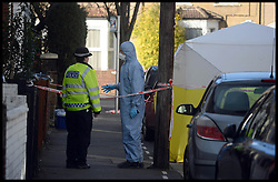 Scenes of Crime Police officers investigate the scene of a double murder of 2 males found dead in car in a residential street in Leytonstone, East London, United Kingdom. Saturday, 1st March 2014. Picture by Andrew Parsons / i-Images