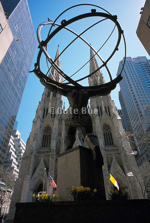 A statue of a man Atlas holding the earth in front of Saint Patrick?s Cathedral NY US