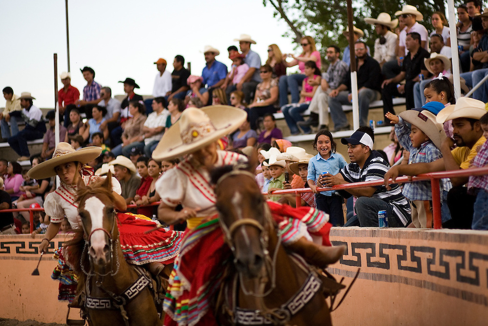 The Valentinas perform the escaramuza at El Bajio in Von Ormy, Texas. Escaramuza is a series of tightly choreographed drills and equestrian maneuvers performed at high speed while riding sidesaddle. The event was adopted in the twentieth century to honor the role of Mexican women in the Revolution of 1910.