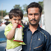 Bashir 29 holding his daughter Zaahra 2 ½ years old, from Chardere district of Afghanistan in Moria camp, Lesvos, Greece