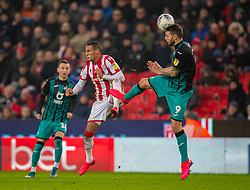 STOKE-ON-TRENT, ENGLAND - Saturday, January 25, 2020: Swansea City's Borja Bastón (R) challenges Stoke City's Tom Ince during the Football League Championship match between Stoke City FC and Swansea City FC at the Britannia Stadium. (Pic by David Rawcliffe/Propaganda)