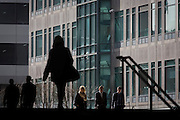 Working Londoners walking through the Broadgate corporate offices development in the City of London.