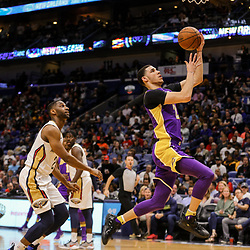 Mar 22, 2018; New Orleans, LA, USA; Los Angeles Lakers guard Lonzo Ball (2) shoots over New Orleans Pelicans guard Ian Clark (2) during the first quarter at the Smoothie King Center. Mandatory Credit: Derick E. Hingle-USA TODAY Sports
