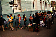 People wait in line to pay their respects to Victor Jara's casket.<br /> After 36 years, Chile's most popular folk singer, Victor Jara was mourned and buried. About 10.000 people attended to his vigil and funeral. Victor Jara was assassinated on September 15 1973 by Pinochet`s military officials of at least 43 gunshots and massive beatings. His 1973 funeral had to be made in private because of military restrictions.