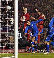Photo. Jed Wee.<br /> Liverpool v Levski Sofia, UEFA Cup, Anfield, Liverpool. 26/02/2004.<br /> Liverpool's Milan Baros (R) heads a rare chance wide.
