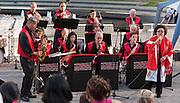 Vocalist Nola Bogle (right) performs with the Minidoka Swing Band at the Bill Naito Legacy Fountain at Waterfront Park, Portland, Oregon. The July 2010 performance was part of the festivities around the rededication of the Japanese American Historical Plaza.