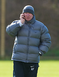 MANCHESTER, ENGLAND - Monday, March 3, 2008: Manchester United's manager Alex Ferguson on his moble phone during training at Carrington ahead of the UEFA Champions League First knockout round 2nd leg match against Olympique Lyonnais. (Photo by David Rawcliffe/Propaganda)