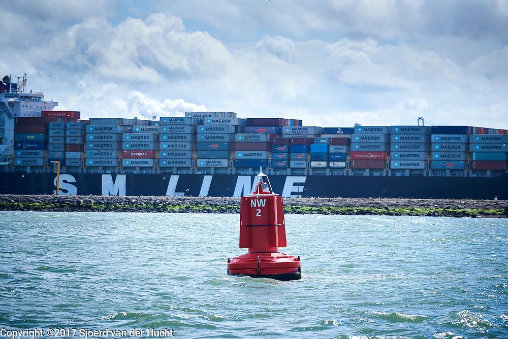 """Vrachtschip vaart over De Nieuwe Waterweg bij Hoek van Holland richting open zee - Cargo boat goes to the sea through The """"Nieuwe Waterweg"""" near Hoek van Holland, The Netherlands"""