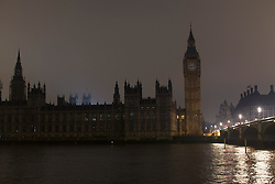 © licensed to London News Pictures. London, UK 23/03/2013. Houses of Parliament goes dark for an hour to participate WWF Earth Hour, which encourages individuals, businesses and organisations to switch off all non-essential lighting between 8:30PM - 9:30PM on Saturday 23 March 2013. Photo credit: Tolga Akmen/LNP
