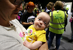 Colm O'Riain holds his 13 week old son Ruairi at the count centre in Dublin's RDS as votes are counted in the referendum on the 8th Amendment of the Irish Constitution which prohibits abortions unless a mother's life is in danger. Picture date: Saturday May 26, 2018. See PA story IRISH Abortion. Photo credit should read: Brian Lawless/PA Wire
