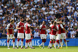 Left to right, Arsenal's Nacho Monreal, Olivier Giroud, Rob Holding, Reiss Nelson, Theo Walcott, Hector Bellerin, Alex Oxlade-Chamberlain, Sead Kolasinac and Granit Xhaka watch the penalty shoot-out from the halfway line