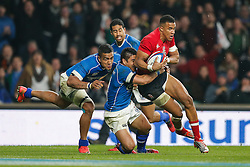 England Winger Anthony Watson offloads in a tackle from Samoa Winger David Lemi (capt) to set up England Full Back Mike Brown for a try - Photo mandatory by-line: Rogan Thomson/JMP - 07966 386802 - 22/11/2014 - SPORT - RUGBY UNION - London, England - Twickenham Stadium - England v Samoa - QBE Autumn Internationals.