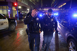 November 20, 2018 - Chicago, Illinois, U.S. - Chicago police comfort one another as they leave the University of Chicago Medical Center. Police payed respect with a procession accompanying an ambulance bearing the body of Officer Samuel Jimenez, who was shot and killed at Mercy Hospital on the  South Side hospital. (Credit Image: © Chris Walker/Chicago Tribune/TNS via ZUMA Wire)