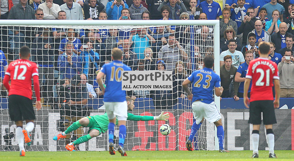 Leicester City's Leonardo Ulloa scores from the spot against Manchester United's David De Gea during the Barclays Premiership match between Leicester City FC and Manchester United FC, at the King Power Stadium, Leicester, 21st September 2014 © Phil Duncan | SportPix.org.uk