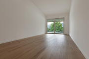 interior of new apartment, wide room with window, parquet floor