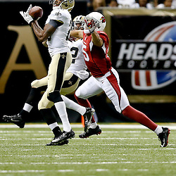 Sep 22, 2013; New Orleans, LA, USA; New Orleans Saints cornerback Keenan Lewis (28) intercepts a pass intended for Arizona Cardinals wide receiver Michael Floyd (15) during the second half of a game at Mercedes-Benz Superdome. The Saints defeated the Cardinals 31-7. Mandatory Credit: Derick E. Hingle-USA TODAY Sports