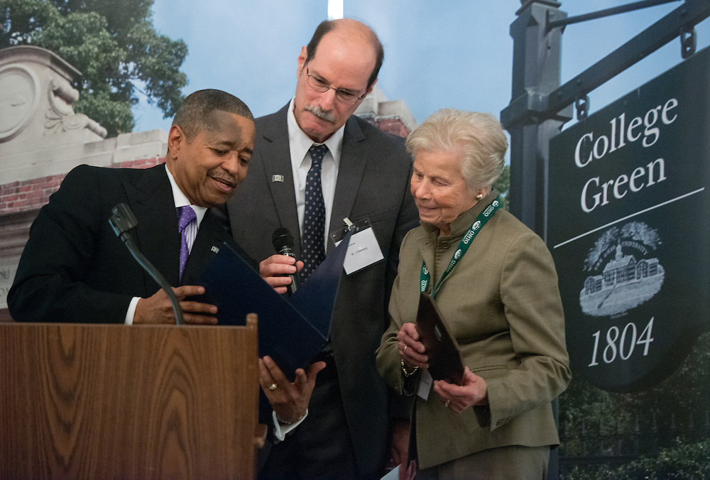 Ohio University President Roderick McDavis (Left) and Professor and Director of the Voinovich School of Public Leadership Mark Weinberg (Center) present Jo Ann Davidson with an award at the 30th Annual State Government Alumni Luncheon. Photo by Ben Siegel