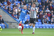 Jack Marriott is challenged by Harrison McGahey during the EFL Sky Bet League 1 match between Peterborough United and Rochdale at London Road, Peterborough, England on 14 April 2018. Picture by Daniel Youngs.