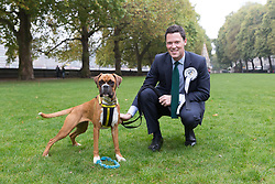 © Licensed to London News Pictures. 26/10/2017. LONDON, UK.  ALEX CHALK MP and a Dogs Trust Rescue Dog at the Westminster Dog of the Year Competition held in Victoria Tower Gardens. The Westminster Dog of the Year Competition is organised jointly by the Kennel Club and the Dogs Trust..  Photo credit: Vickie Flores/LNP