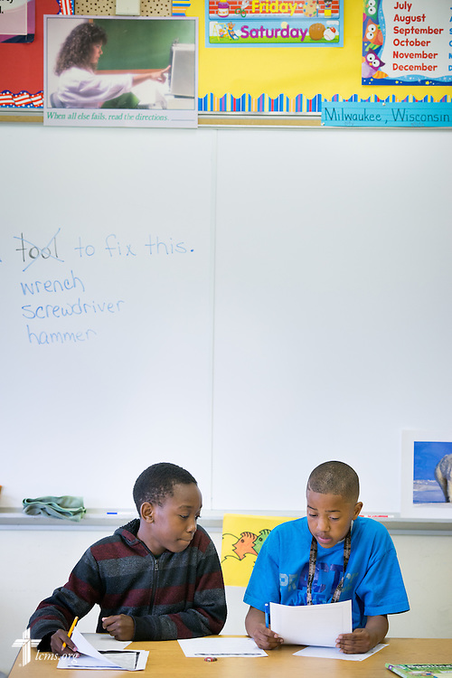 Dominique Brown and Josiah Knox (right) work together during class at Lutheran Special School & Education Services, located in Milwaukee Lutheran High School, on Tuesday, May 19, 2015, in Milwaukee, Wis. LCMS Communications/Erik M. Lunsford